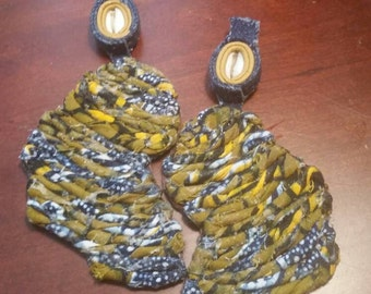 Leather earrings, with ankara, african fabric and cowrie shells.