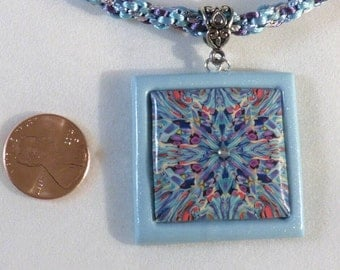 Explosive looking purple and blue polymer clay necklace