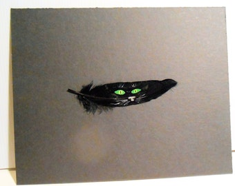 Black cat face feather painting .