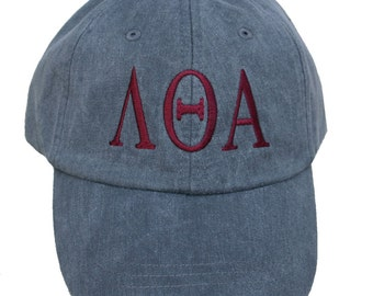 Lambda Theta Alpha baseball cap with embroidered greek letters