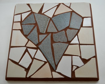 mosaic trivet, stepping stone, or home decor; robin's egg blue heart on white background, grouted in terra cotta; 9 inch or 22 cm square