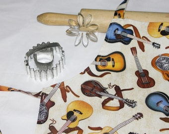 Guitars on Cream Child Apron