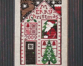OOP 2009 Limited Edition Must Be Santa Claus Christmas cross stitch pattern by Prairie Schooler at cottageneedle.com Winter December