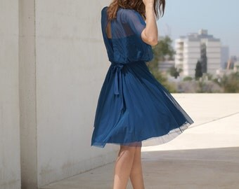 Blue evening knee length dress,two layers, folds at neck line,open back ,full circle skirt