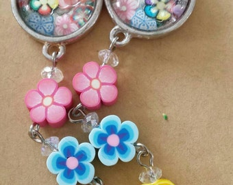Sale was 10 now 9uk Silvertone Round Cabochon with fimo flower dangles.