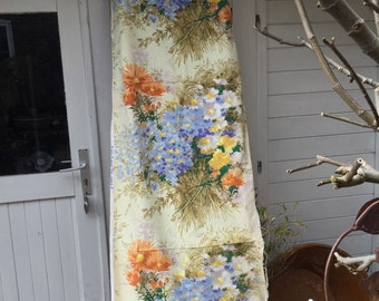 Two drops of vintage floral soft furnishing fabric