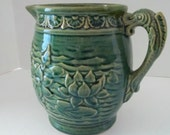 McCoy Pottery Green Lotus Flower Water Lily Fish Handle Pitcher