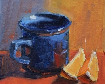 Blue Cup on Red and Oranges