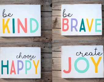 Set of colorful wooden signs, be kind, be brave, choose happy and create joy