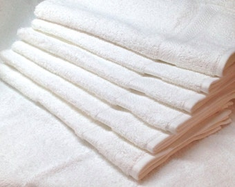 Bundle of 6 monogrammed white hand towels from Grandeur hospitality, 100% cotton