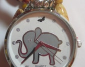 Watch/Wooden Stretch Band/Elephant with Butterfly/Large Golden Glass Seed Beads/Quartz Movement/Antique Silver Elephant Beads