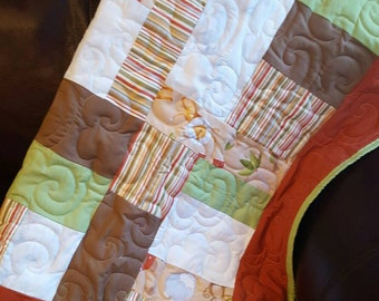 "Baby Animal Safari 39"" x 42"" Patch Work Quilt with striped backing."