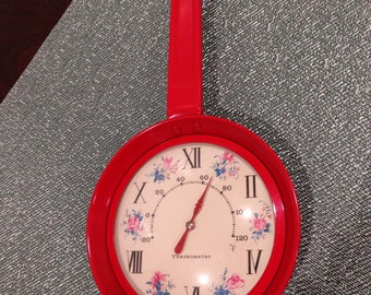 vintage red metal pan shaped thermometer