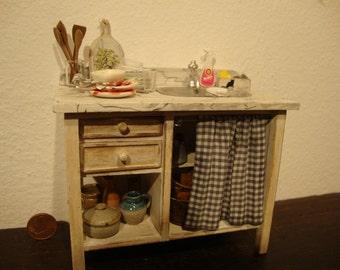 Miniature dollhouse Tuscan-style kitchen sink