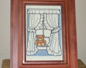 Vintage cross stitched picture in frame