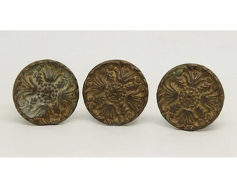 Set of three brass ornate drawer knobs