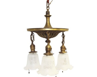 Three down light brass chandelier with glass shades