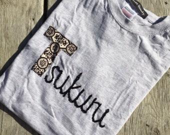 Applique & hand embroidered slogan tee