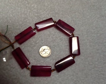 Magenta and dark purple colored agate beads
