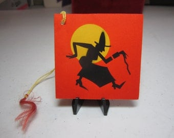 Vintage 1930's-40's unused art deco bright orange halloween bridge tally with silhouette of old witch with cane walking past full moon