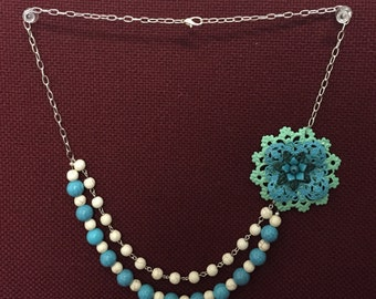 Multistrand flower necklace and matching earrings