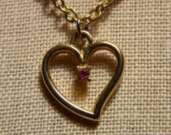Valentine gold heart necklace with pink gem set