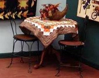 An Autumn Day Quilt ~39 inch square In Fall colors, orange, brown, and gold.