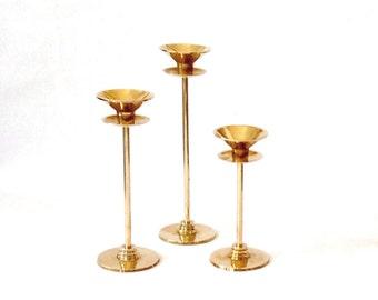Trio of Graphic Brass Candlesticks