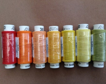 Seven spools of Czech cotton lacemaking thread - red, oranges, yellows and green