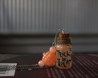 Glow in the dark trick or treat orange halloween bottle necklace