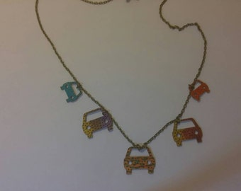 Laser cut wood and chain necklace with small cars.