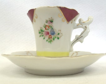 Japanese China Demitasse Cup and Saucer, Floral with Red, Yellow and Gold Trim