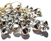 SUPPLY: 25 Silver Tone Pinched Bell Charms - Indian Historical Belly Dancing Bells - (1-F1-00003786)
