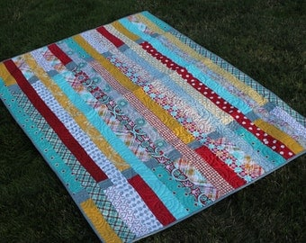 Fun Striped Baby Quilt in Turquoise, Red and Yellow