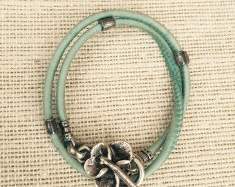 Turquoise Wrap Around Bracelet. Leather Wrap. Unusual clasp.Orchid Flower Charm Pendant.Weathered Teal.Aqua Blue Distressed