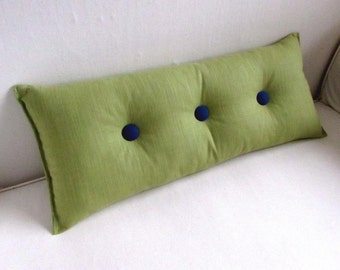 decorative lumbar pillow in PEAR GREEN with navy buttons