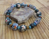 African Zebra trade bead bracelet with black star beads, turquoise wood spacers, and black and brown wood beads