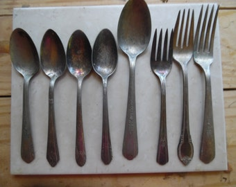 8 pieces of Vintage Silverplate forksand  spoons need to be polished good condition...