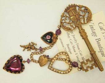 "Vintage Charm Brooch Pin - Aged Gold Heart / Cupid Charms - Stamped Metal Key - Enamel & Rhinestones - Gold Metal Chain - 2.75"" x 4.25"""