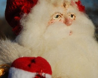 OOAK Primitive/Victorian Santa with hand sculpted papier mache face.  Hand crafted Christmas item.