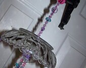 A little pink and a little purple sun catcher / wind chime