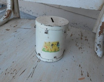 vintage tin child's bank with decal
