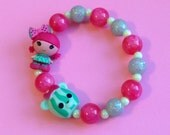 Lalaloopsy Water Mellie Seeds Watermelon Girl and Bear Doll Stretch Bracelet