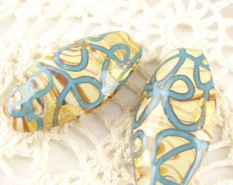 Blue Swirls Beige Oval Lampwork Focal beads (2)