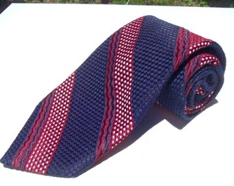 Vintage 1970s Wide Red and Blue Polyester Tie with Textured Stripes from X Andrini