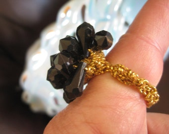 Stretch black faceted ring Very good