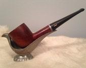 AJ - This is a vintage Purex Superfine tobacco pipe