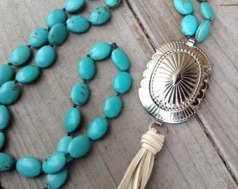 Western silver concho and buckskin deerskin tassel with knotted turquoise magnesite necklace