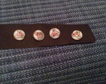 Pretty little antique enamel buttons