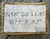 Color Photograph of the Ocean City MD map coordinates transferred onto reclaimed boardwalk wood